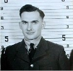 Photo of Lawrance McMillan– This picture of McMillan is taken from his Pers file in the Archives at Ottawa.  His bare uniform and lack of stripes make this an intake photo.  Source: Whitehouse via Archives Canada