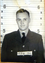 Photo of James Goodfellow– This is the photo of Jim that is shown on his ID Card.  It would have been taken when he first joined up at the Manning Depot in Toronto in April of 1942.  All photos and documents have been taken from his file in the Archives of Canada and are shown whith the permission of the LAC.  His file is found in (box) RG24 Vol 27613.  Source: Library and Archives Canada via Robert Whitehouse