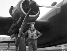 Photo of GORDON HERBERT LAWSON– 21 March 1943 Canadian serving with an Australian (R.A.A.F.) torpedo bomber sqn in Malta.  F/0 Gordon Lawson of Grandview, Man. who is captain of the bomber stands beside his aircraft which is all ready for another show, Lawson used to be a miner in Manitoba.