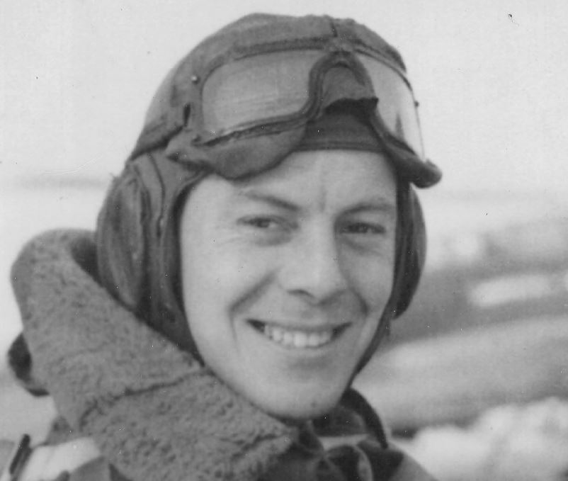 Photo of JAMES LOWRY– Jim Lowry in his Spitfire circa 1942-1943