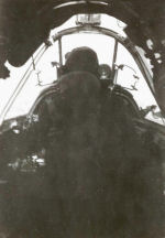 Photo of Frederick Albert Duquette– Frederick Albert Duquette in cockpit during flight mission 1942 taken by radio operator Art Johnson.