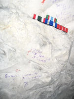 Inscription– Harold Barker's name and service number written in a tunnel below Loos.  In memoriam to him, I placed a set of my ribbons above it in the chalk.