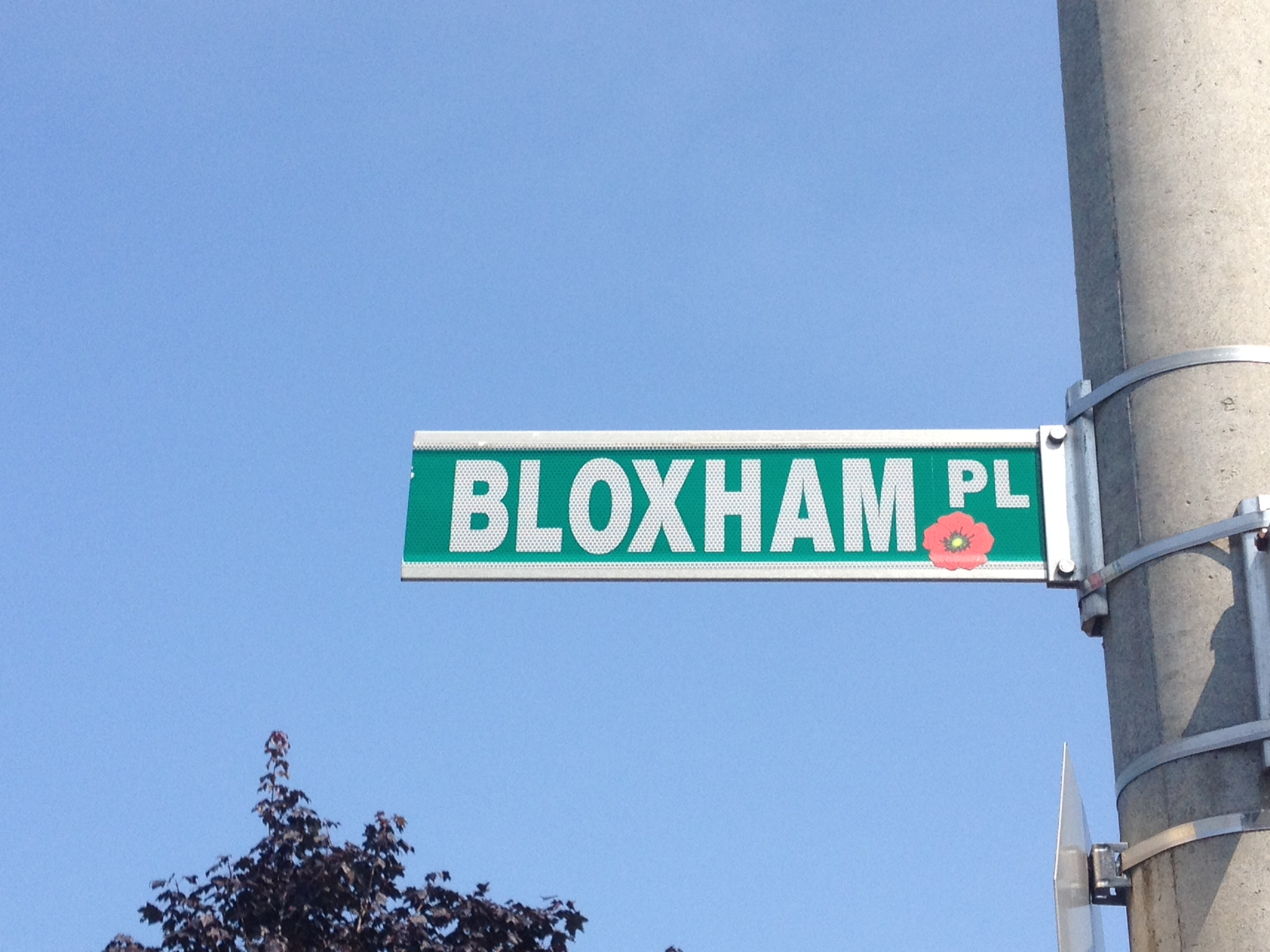 Street sign– Barrie street named in honour of Lance Corporal Joseph Percival Bloxham with a poppy.
