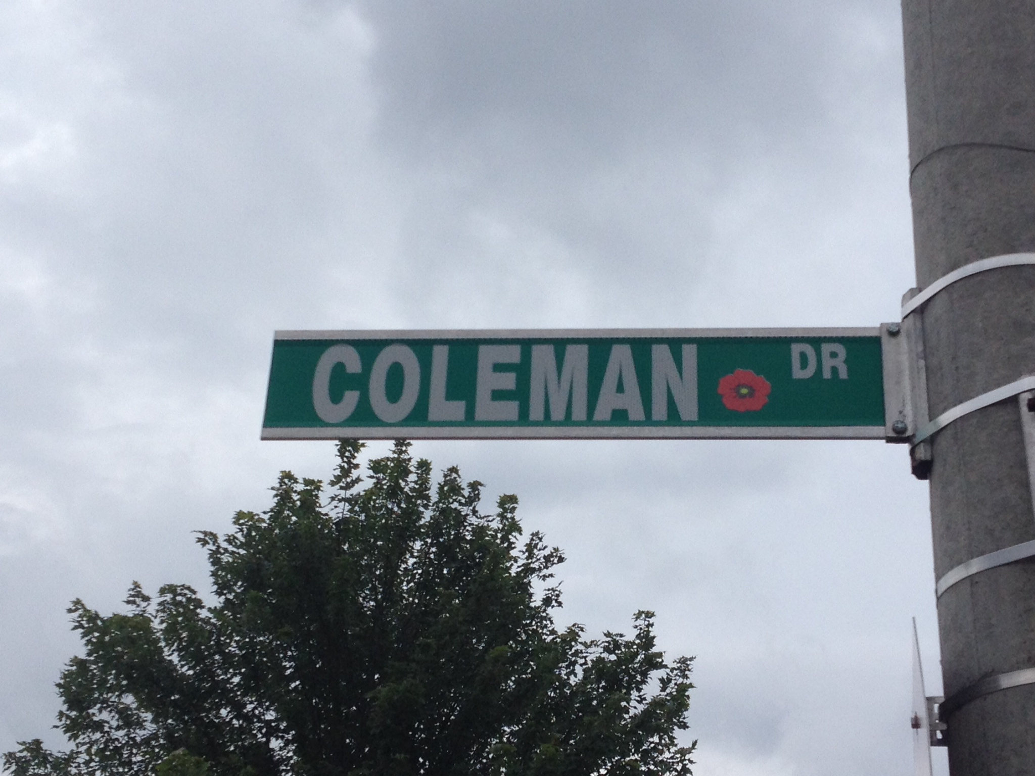 Street sign– Barrie street named in honour of Corporal William Richard Coleman with a poppy.