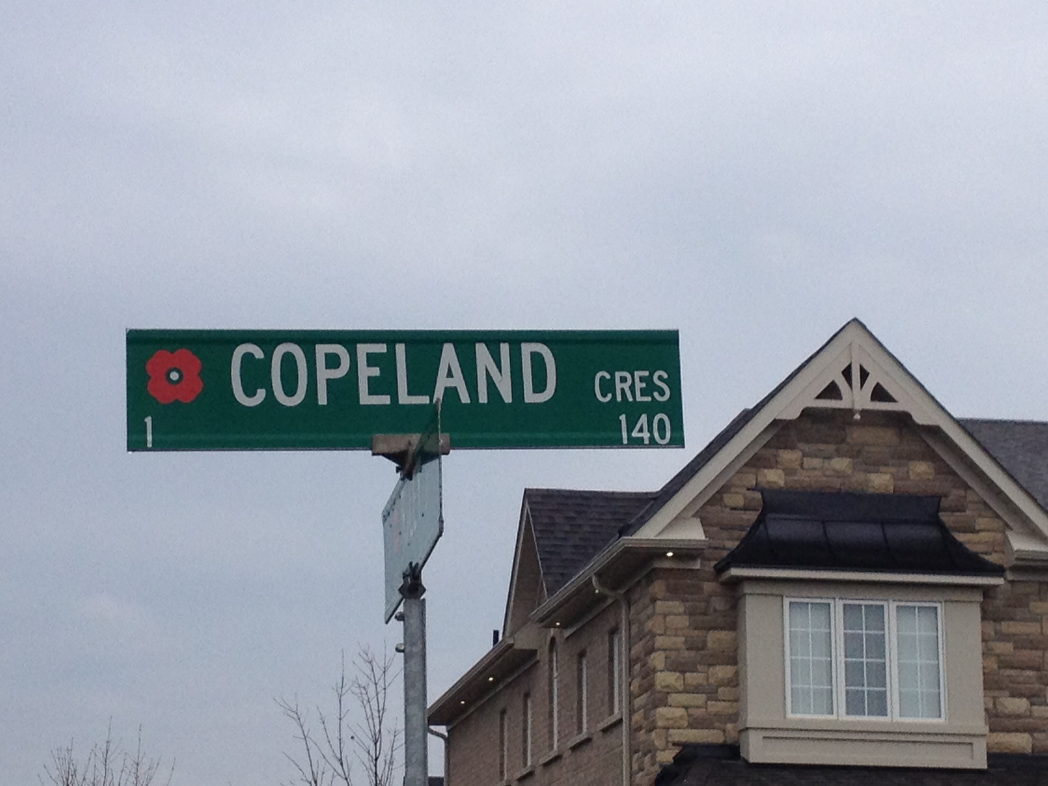 Street Sign– Cookstown street named in honour of Private George Copeland with a poppy.