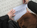 Inscription on Vimy Memorial– MP Irene Mathyssen takes a pencil impression of her great uncle's name from the memorial wall.