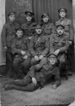 Group Photo– A photograph of N.C.O.s of the 3rd (Toronto Regiment) Battalion taken the Fall of 1915 near Ploegsteert Woods, Belgium. Sergeant John A. Newton #426149 is lying at the front with his friends.  From the Bob Richardson Collection