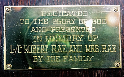 Memorial– This pew at Wesley United Church, 130 Brodie Street North, Thunder Bay, ON was dedicated to the memory of L/C Robert Rae and Mrs. Rae by their family. L/C Rae died on 16 September 1916 and is buried in a cemetery near the Vimy Memorial in Pas de Calais, France.