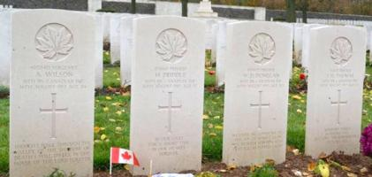 Grave marker– The group of four who were identified and reburied.  Courtesy of Glenn Kerr