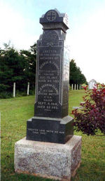 """Memorial– This memorial marble shaft at lot 16, Cemetery, Highway 12, Miscouche, PE is dedicated to Private George A. Thompson and Gunner J. Herman Clarke, both killed during the First World War. It now serves veterans of the Second World War also. This monument was organized by Mrs. Edward Millar, and was unveiled by John Barrett a World War I veteran who served overseas. Funds for the monument were donated by area residents and businesses. --------------------------------------------------------------------------------  [front/devant]  ERECTED TO THE LOVING MEMORY OF   PTE. GEORGE A. THOMPSON  15TH CAN. BATT., KILLED AUG. 15, 1917, AGED 24 YRS   GR. J. HERMAN CLARKE  8TH CAN. SEIGE BATTY., C.G.A., KILLED SEPT. 9, 1918, AGED 22 YRS.   """"GREATER LOVE HATH NO MAN THAN THIS"""" http://www.cmp-cpm.forces.gc.ca/dhh-dhp/nic-inm/sm-rm/mdsr-rdr-eng.asp?PID=2511 Photo Credit: Sgt. G.E. Gallant"""