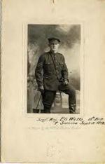 Photo of Eli Watts– Serg't Maj. Eli Watts, 18th Batt. [Symbol of cross] Somme Sept. 15 1916. A portrait by the U.S.A. Studios, London.