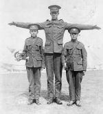 Photo of Alfred Williams– Lance Corporal Alfred Firmston Williams (middle). According to his attestation papers, he was listed at 6 feet 5.
