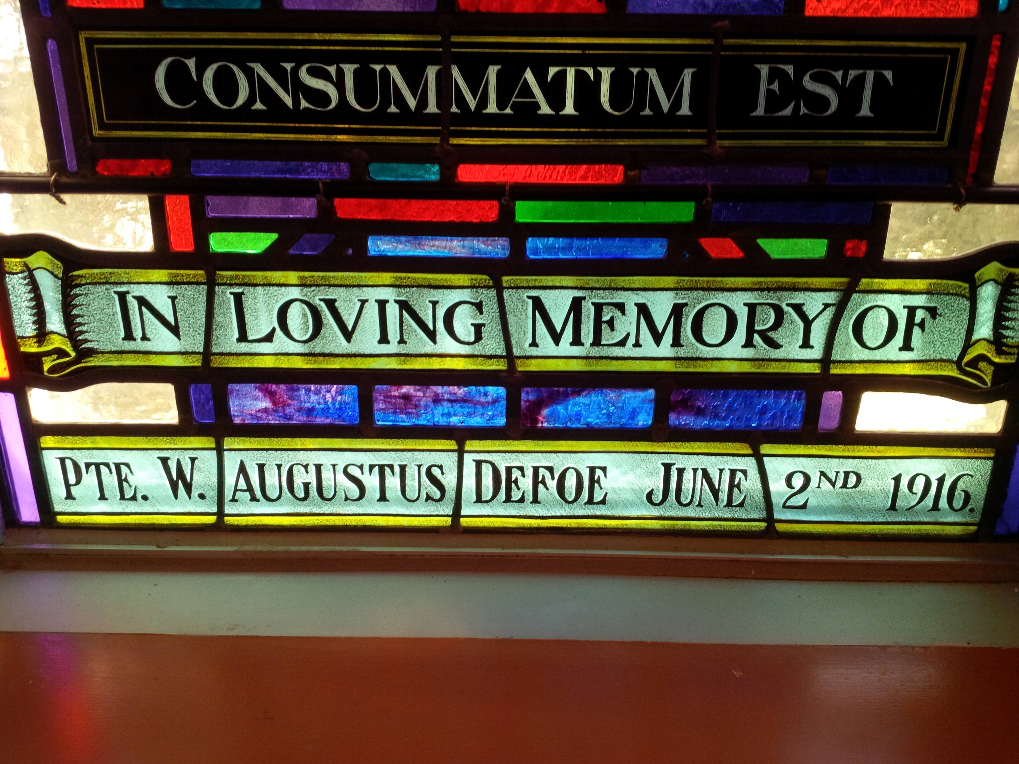 Memorial Stained Glass– Pvt. W.Augustus Defoe's name on stain glass window in Sts. Cyril and Methodius Roman Catholic Church in Mississauga, Ontario.  The stain glass was originally in St. Basil's Church in Toronto.