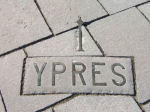 Inscription– Sign in Belgium on a monument floor showing the direction to Ypres, Belgium where Robert Carlton Grant was killed.  We are close friends of Robert Carlton Grant's great niece and she has given permission for the publication of his information.