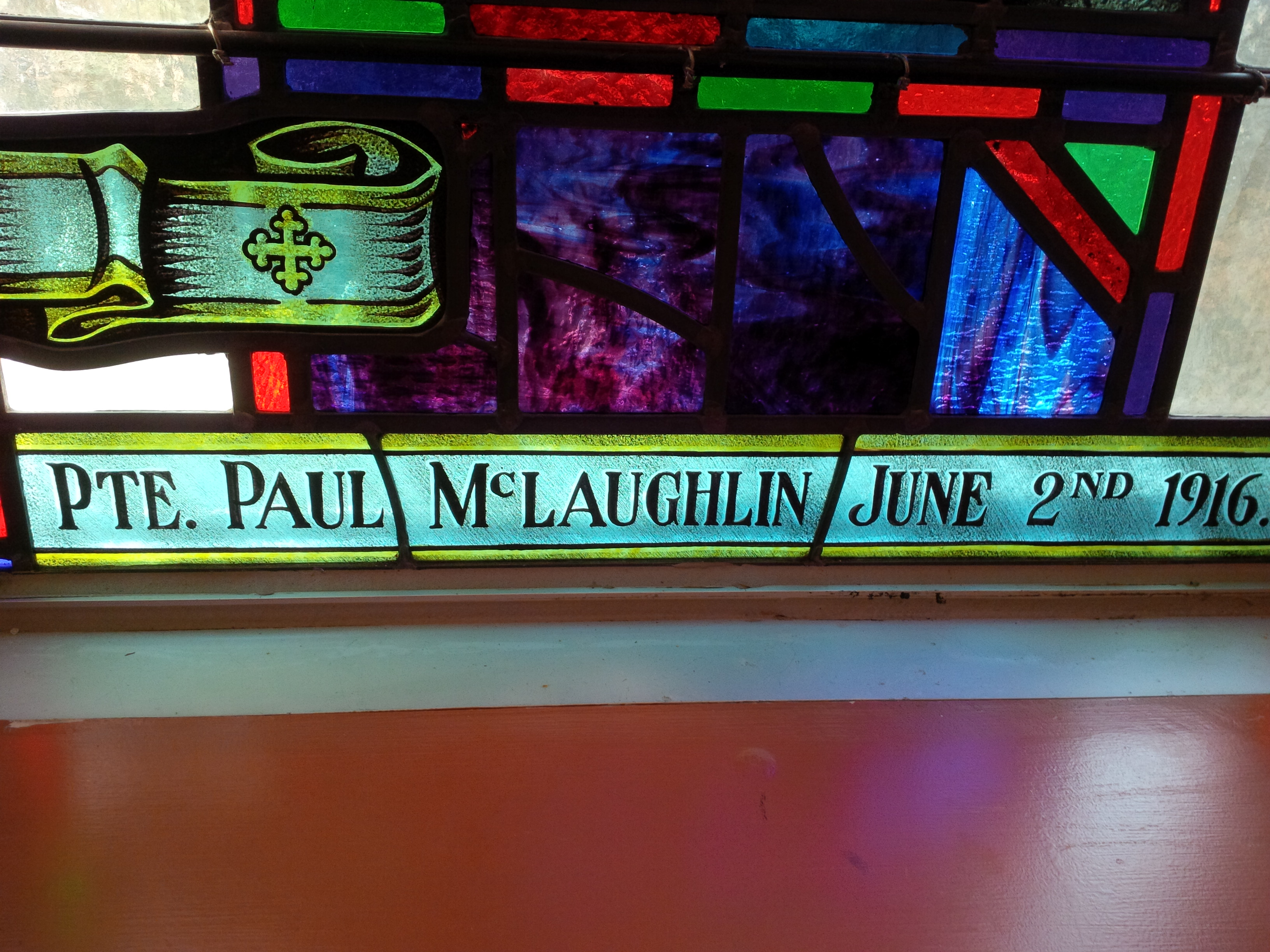 Memorial Stained Glass– Pvt. Paul Mclaughlin's name on stain glass window in Sts. Cyril and Methodius Roman Catholic Church in Mississauga, Ontario.  The stain glass was originally in St. Basil's Church in Toronto.