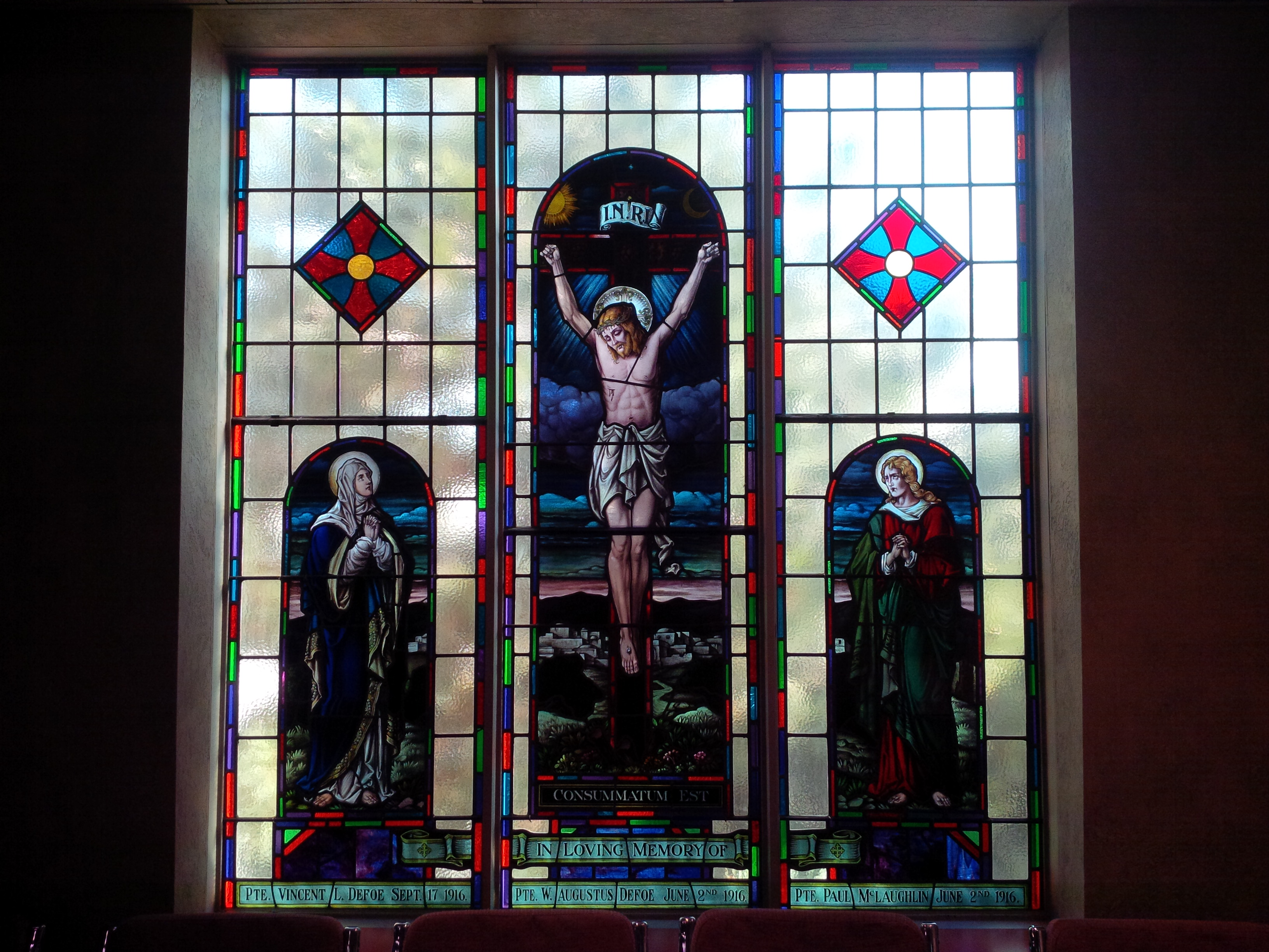 Memorial Stained Glass– Pvt. Paul Mclaughlin's name on stain glass window (bottom right) in Sts. Cyril and Methodius Roman Catholic Church in Mississauga, Ontario.  The stain glass was originally in St. Basil's Church in Toronto.