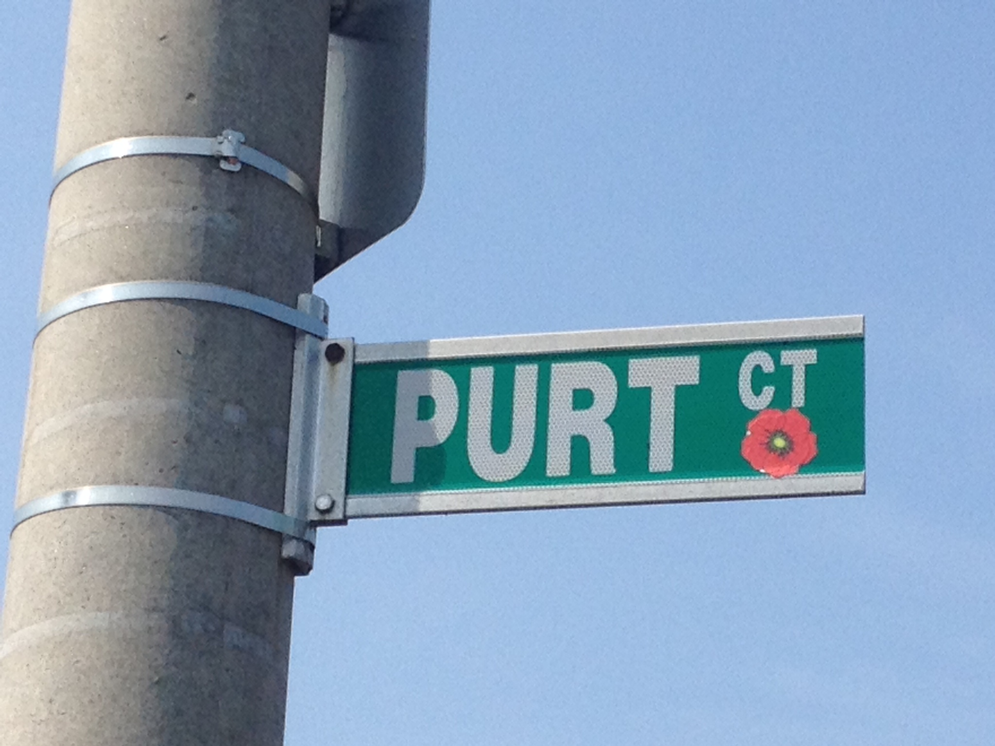 Street sign– Barrie street named in honour of Private James Harry Purt with a poppy.