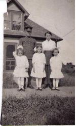 Family photo– Pte Robert Jay Smith with is wife Mary and his 3 daughters, Edna,Laura and Mercy. Their fourth child,Robert Jay Smith JR born May 11, 1917 while Pte Robert was at war. He never met his father. This picture was taken outside their home in Bradwell Saskachewan. In this photo Mary is pregnant.