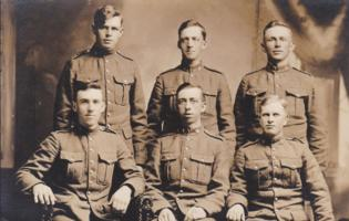 Group Photo– Gordon D Thomas (seated far left) and Thomas McAndless (standing behind him) WW1 Included this photo of his mates.
