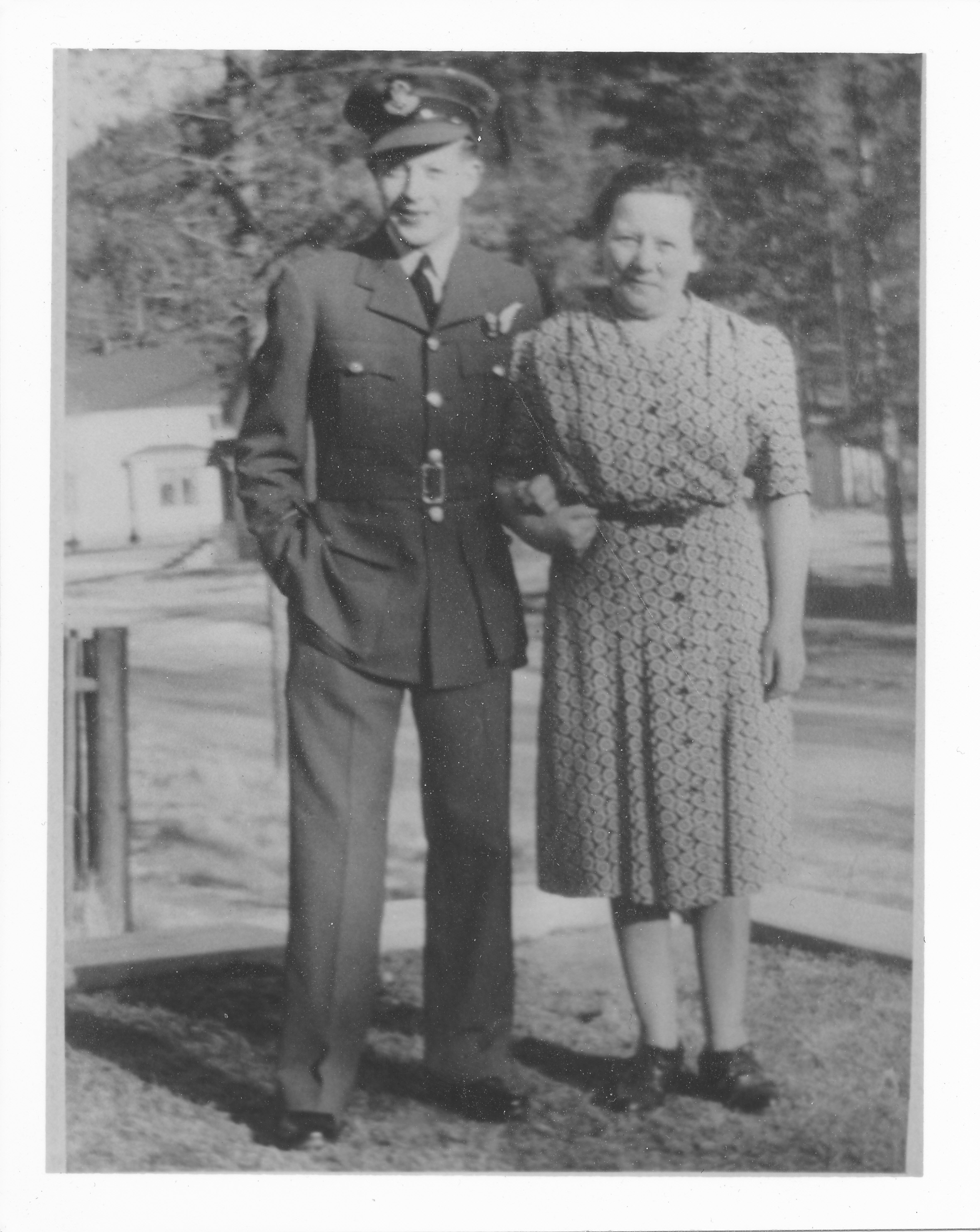 Group Photo– Gordon Hoggard with this mother Jane Ann Hoggard in front of their residence at 345 Otter Street Banff, Alberta.