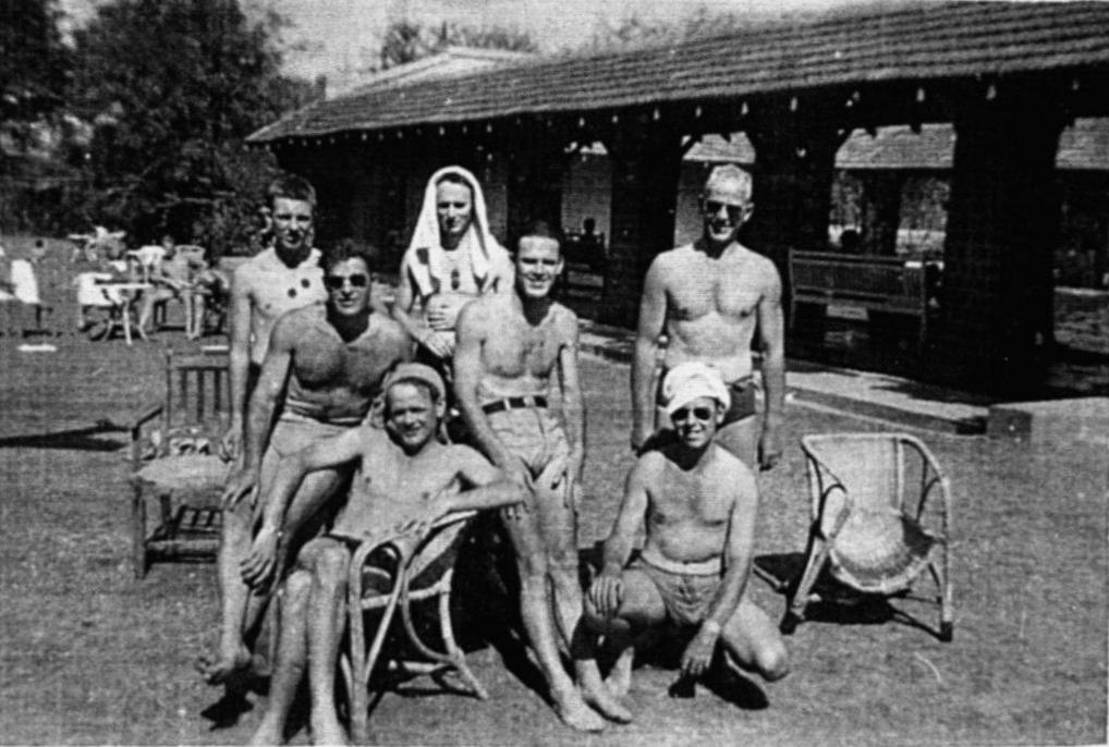 """Group Photo– Members of two RCAF Liberator crews relaxing at Poona Swim Club, India in March 1945.  Of the eight RCAF crewmen of Liberator KH326 who failed to return from an RAF 357 Squadron Special Duties operation on 6 June 1945 (supply drop to Force 136 operatives behind Japanese lines), at least two are identified here:  J/12779 Flight Lieutenant Arie Frank TIMMERMANS:  Captain of the aircraft (pilot).  Age 28, son of Frank Joseph and Maude Gladys Timmermans of Blind River, Ontario; husband of Mary Constance Timmermans (nee Galashan), of Burlington, Ontario.  He is standing at right, wearing sunglasses.   J/47321 Flying Officer William Walker REEVE:  Air Bomber.  Age 29, son of John Thomas Reeve and Margaret S. Reeve, of Owen Sound, Ontario.  He is seen at center, wearing a dark belt, to the left of Arie Timmermans.  Squatting in front of Timmermans, with sunglasses, is his close friend & fellow Liberator pilot, RCAF C.1490 S/Ldr O.A.H. """"Haig"""" SIMS."""