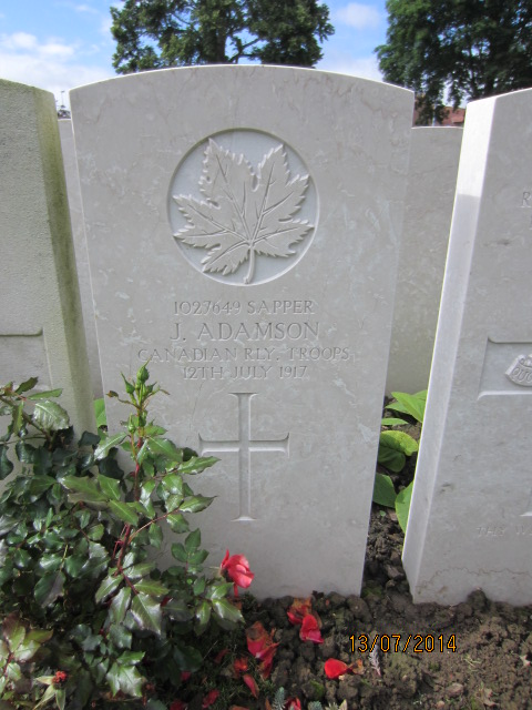 Grave marker– Grave marker at Bailleul Communal Cemetery in France showing inscription for Sapper Joseph Adamson. Image taken 13 July 2014 by Tom Tulloch.