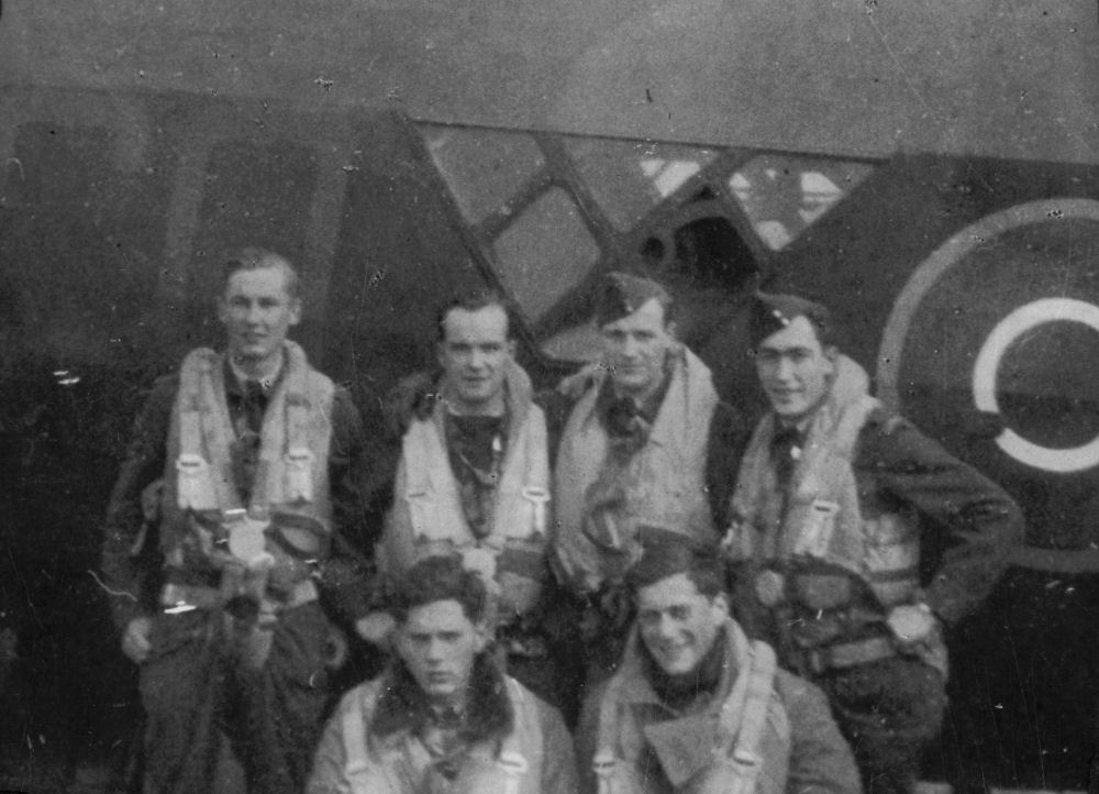 Group Photo– Joe Friedman's crew posing near their Wellington bomber. Top row: Bob White (Wireless Operator); Norm Waring (Bomb Aimer); Taite Roth (Pilot); George Barry (Navigator). Bottom row: Joe Friedman (Tail Gunner), Mark Goldwater (Mid-Upper Gunner). Aside from Mr. Friedman all of these men were killed in action on December 12, 1944.The Memory Project / www.thememoryproject.com