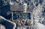 Plaque– Plaque embedded in rock on shore of Beck Island, Bellows Lake, Saskatchewan to honour Flying Officer John Beck, RCAF, killed in action 21 February 1945 over Dortmund, Germany