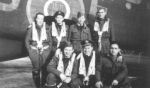 Group Photo– Crew of Lancaster PB451. On 19 March 1945, PB451 was airborne 0132 from Gransden Lodge O/P Witten, Germany, from which it failed to return.  The crew are buried in Rheinberg War Cemetery. They are: F/O (P) G.E.Peaker age 33 from Saskatoon;  Sgt A.Kirkcaldy, F/O (N) E.Hayes age 21 Vancouver;  F/O (BA) R.S.Butterworth age 26 Ottawa;  Sgt R.P.Smith RAF; WO2 (WAG) R.M.Baker age 22 Toronto; F/S (AG) E.F.Perrault age 20 Fort Francis;  F/S (AG) J.P.H.Adam age 21 Tecumseh, Ontario. (F/O Butterworth was from Richville, New York.)
