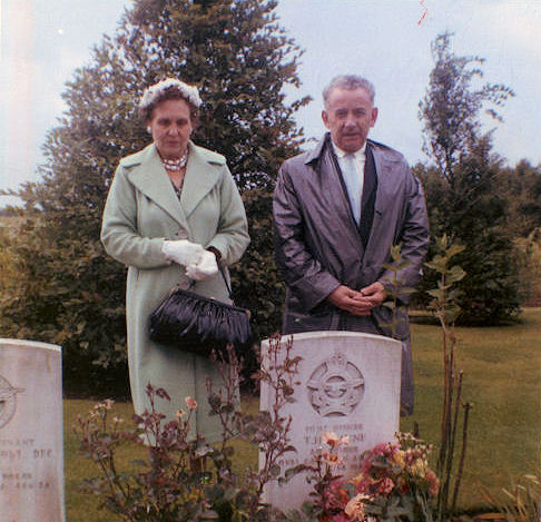 Paying respects– This image is of my grandparents, uncle Tommy's mom and dad, was taken at the Rheinburg War Cemetery taken in 1959 in front of Uncle Tommy's grave.