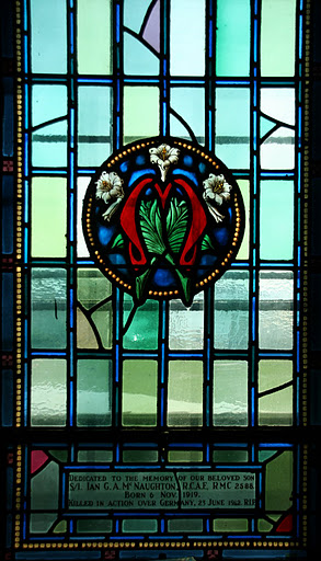 Memorial Stained Glass– Memorial to Ian G. A. McNaughton, son of Genl. Andrew G.L McNaughton CEF/WW2 and Mabel (nee Weir; sibling to Andrew R.L. McNaughton, Bgdr-Genl. Edward M D Leslie, sisters Leslie A Sykes and late Christina Pauline Stuart McDougall. In St. Raphael Roman Catholic Chapel Yeo Hall Royal Military College of Canada