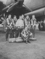 """RCAF Air Crew, #426 Thunderbird Squadron (On Wings of Fire)– Pilot Officer, AG (Air Gunner), Harold James Hurley, J19164, (wearing RCAF issue sweater), with Air Crew, #426 Thunderbird Squadron (On Wings of Fire), 7th Bomber Squadron, in front of Lancaster Mark II aircraft, #DS 846, """"Old Black Magic"""".  Harold Hurley, age 33 and crew were killed in action December 16, 1943.  Target: Berlin, Germany.  Shot down by a German night fighter aircraft during night operations against Berlin Germany.  Photograph credit: Cecil Vincent Thomas Hurley, Sargent First Class, RCAF #419 Photographic Squadron, brother of Harold Hurley.  Taken at Dishforth, Yorkshire Airfield, England, 1943."""