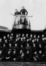 """RCAF #426 Thunderbird Squadron (On Wings of Fire)– RCAF #426 Thunderbird Squadron (On Wings of Fire), 7th Bomber Squadron, in front of Lancaster Mark II aircraft.  """"Old Black Magic"""". – Pilot Officer, AG (Air Gunner), Harold James Hurley, J19164, (second from left), with Air Crew, 7th Bomber Squadron. Harold Hurley, age 33 and crew were killed in action December 16, 1943. Target: Berlin, Germany. Shot down by a German night fighter aircraft during night operations against Berlin Germany. Photo credit: Cecil Vincent Thomas Hurley, Sargent First Class, RCAF, R111409, #419 Photographic Squadron, brother of Harold Hurley. Taken at Dishforth, Yorkshire Airfield, England, 1943."""