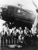 """RCAF Air Crew, #426 Thunderbird Squadron (On Wings of Fire) in front of Lancaster Mark II aircraft,– Pilot Officer, AG (Air Gunner), Harold James Hurley, J19164, (second from left), with Air Crew, #426 Thunderbird Squadron (On Wings of Fire), 7th Bomber Squadron, in front of Lancaster Mark II aircraft, #DS 846, """"Old Black Magic"""". Harold Hurley, age 33 and crew were killed in action December 16, 1943. Target: Berlin, Germany. Shot down by a German night fighter aircraft during night operations against Berlin Germany.  Photographic credit: Cecil Vincent Thomas Hurley, Sargent First Class, RCAF #419 Photographic Squadron, brother of Harold Hurley. Taken at Dishforth, Yorkshire Airfield, England, 1943."""
