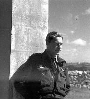 Photo of Cyril (Cy) Gosling– 20 March 1943 - Malta pilot who has been doing his share in the island's offensive is F/O Cyril (Cy) Gosling of North Battleford, Saskatchewan. On a recent sweep Gosling sighted an Italian Cant float plane about to take off from its base. Above his right breast pocket he has a pair of Italian wings which he wears as a souvenir.