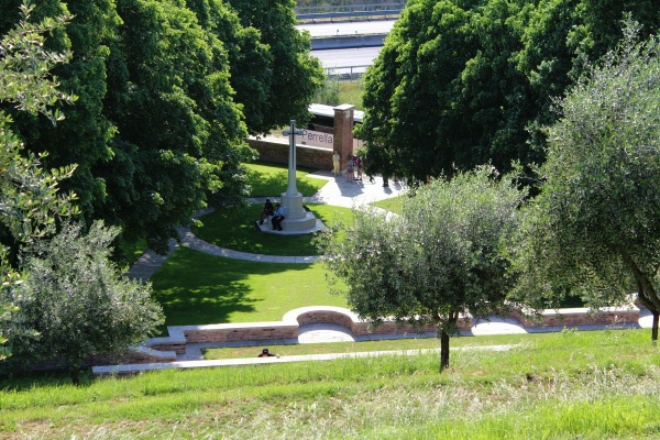 Cemetery– View of the Cross of Sacrifice from the tiered rows of Gradara War Cemetery - May 2013 .