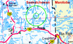 """Schmidt Bay Road Map– Schmidt Bay is part of Wildnest Lake, Saskatchewan, and found near the Manitoba border, about 40 kilometres (25 miles) north-west of Flin Flon. The smaller green circle indicates the general area of Schmidt Bay. Please see the """"Schmidt Bay Local Area Map"""" for more specific details."""