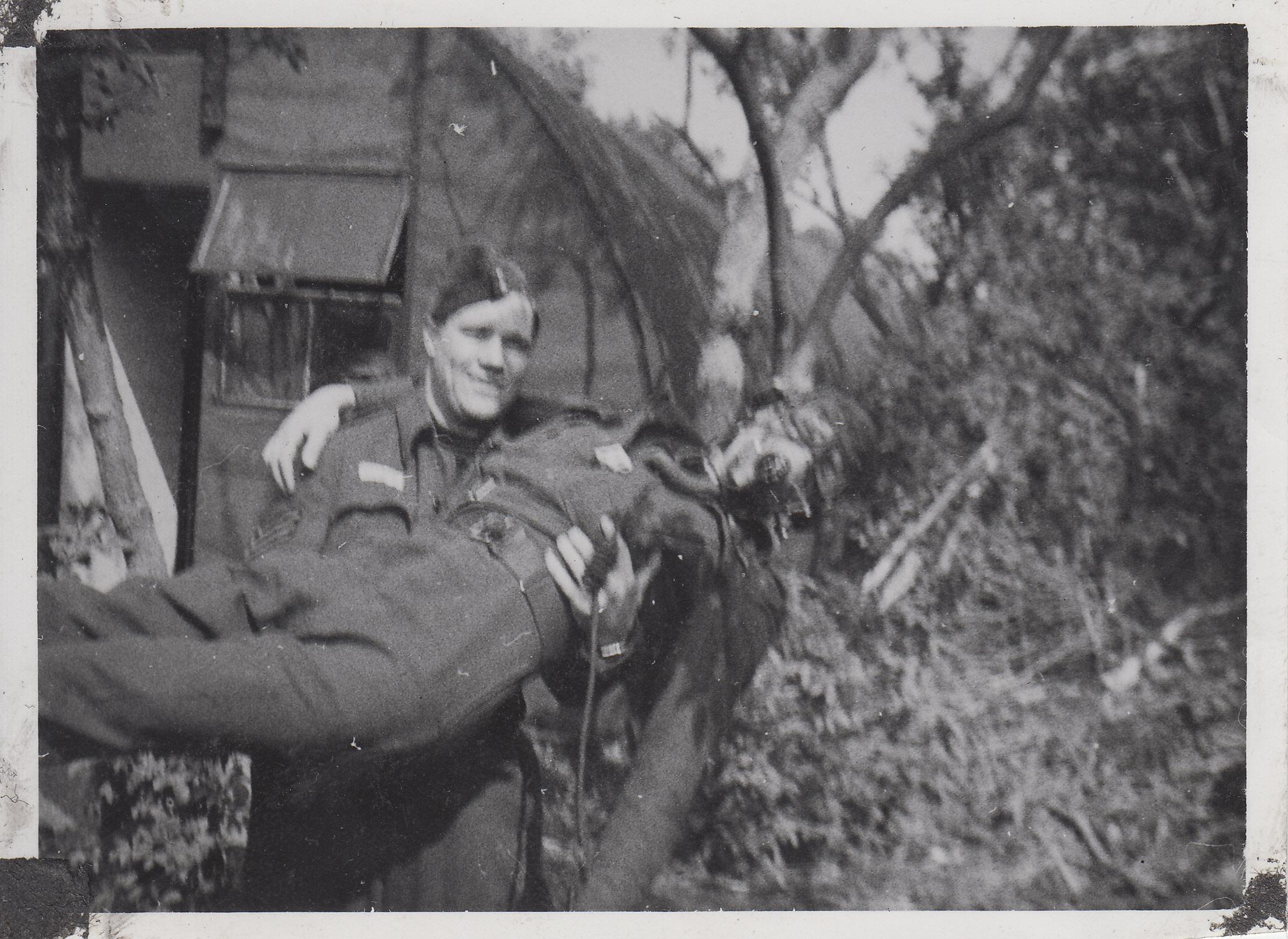 "Group Photo– Richard ""Spud"" Talman holding C.R Jones (pilot), goofing around in 1943,"