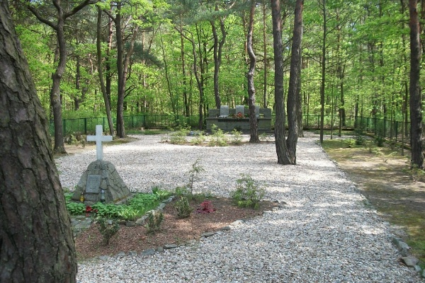 """Memorial– Memorial Garden - The plaque under the cross reads """"Erected by the Prisoners of War of the allied air forces in honoured memory of their comrades who died at Stalag Luft 3 during the war AD 1939-1945 Per Ardua ad Astra"""" ... Stalag Luft III, Zagan, Poland … photo courtesy of Marg Liessens"""