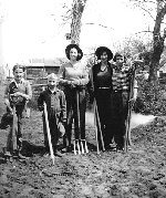 Family photo– Howie (far left), Geordie, Ollie, Edie and Mary Gould helping with the vegetable garden in the back yard of their parents' home on Robertson Street in Maryfield, Saskatchewan.