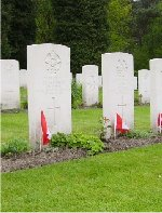Row of Gravemarkers– This set of headstones is a crew from 431 Squadron, that went down over Hamburg, Germany on March 31, 1945, in Lancaster KB-859, coded SE-U. From left to right, the names read: Albert Dorey, Patrick Dennison, John Casey, Martin Hartog, Frederick Alty and John Mercer of the RAFVR.