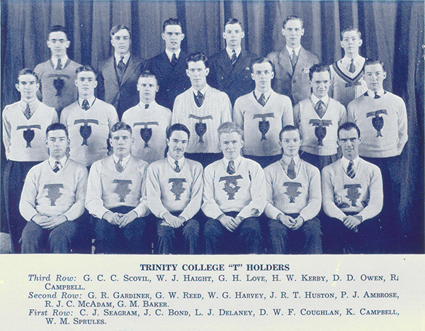 """Photo– Group photograph showing Kerby with fellow school athletes. The """"T"""" means that the athletes played on an intercollegiate team. Kerby is shown in back row, fourth from photo left. From Torontonensis yearbook 1938."""
