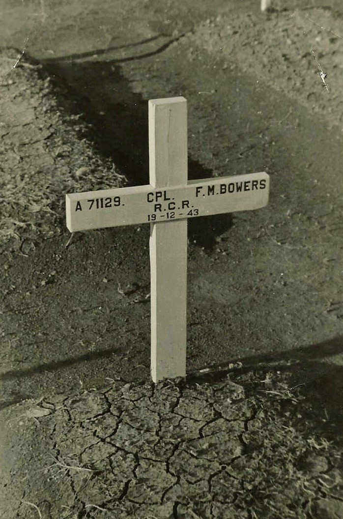 """Temporary Grave Marker– Grave site at the Morro River Cemetery, Ortona, Italy.  On the reverse of this photo, it states """" This is a temporary wooden Cross, which the Imperial War Graves Commission will replace with a permanent Headstone.""""  It also indicates the Graves Registration & Inquiries (Records) C.A.F. """"G5 RG Pl3"""""""