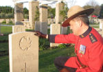 Paying respects– Superintendent Greg Peters of the RCMP at the gravesite of Edison Alexander Cameron.