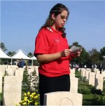 Photo of Maureenn Story– Maureen Story gives her commemorative presentation on the life of her great uncle, John Fehr, at the Moro River Canadian War Cemetery.