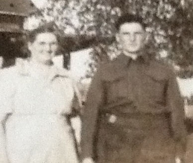 Group Photo– Uncle Wesley & his Mom, Edna Harris so proud & holding hands right before he was shipped overseas. Picture taken in front of my grandmothers house in Exmore, NB.