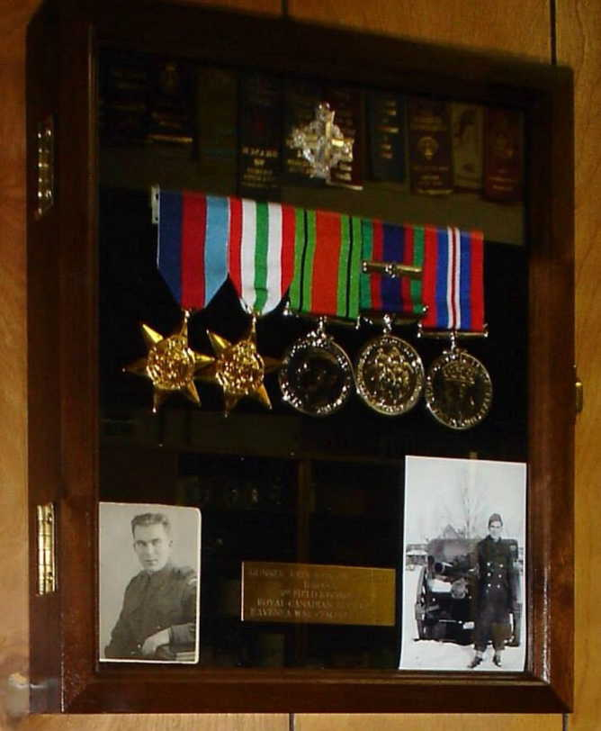 Military medals and photos