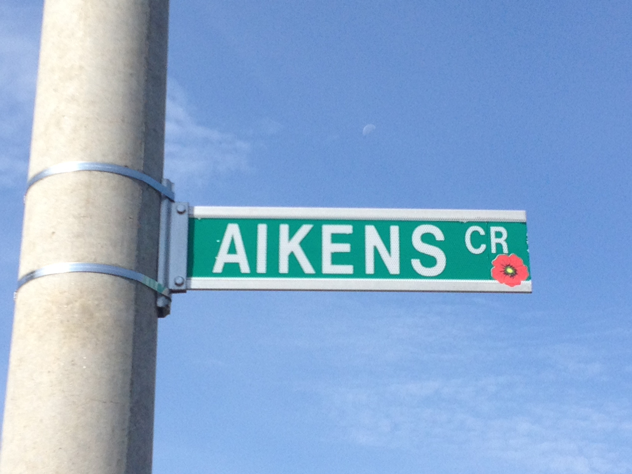Street sign– Barrie street named in honour of Sergeant Ernest Alexander Aikins with a poppy.