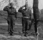 Paying respects– This photo was taken on April 26th, 1945.  The person to the right is Wallace Alward, Leon's brother.  This photo was taken at Leon Alward's grave, eight days after his death.