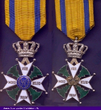 """Knights Cross Medal– This medal represents an appointment of a """"Knight of  the fourth class of the Militaire Willemsorde"""". It was awarded by Queen Wilhelmina of the Netherlands to honour Brave Canadians who gave thier lives to liberate the Netherlands. The left is the front of the medal, the right is the back."""
